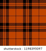 Orange and black tartan plaid Scottish seamless pattern.Texture from tartan, plaid, tablecloths, clothes, shirts, dresses, paper, bedding, blankets and other textile products.