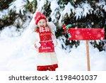 happy child in knitted reindeer ... | Shutterstock . vector #1198401037