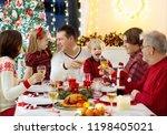 family with children eating... | Shutterstock . vector #1198405021
