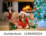 children at christmas tree and... | Shutterstock . vector #1198405024