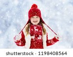 child in red hat playing in... | Shutterstock . vector #1198408564