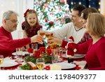 family with children eating...   Shutterstock . vector #1198409377