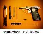 disassembled pistol and... | Shutterstock . vector #1198409557
