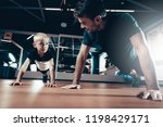 father and son are doing push... | Shutterstock . vector #1198429171