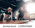 father and son are doing push... | Shutterstock . vector #1198429684