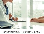 woman doctor talks to female...   Shutterstock . vector #1198431757