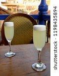 two glass of peruvian pisco... | Shutterstock . vector #1198435894