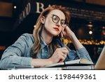 sad student girl sitting in... | Shutterstock . vector #1198449361