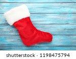 christmas stocking on blue... | Shutterstock . vector #1198475794