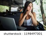 attractive female freelance... | Shutterstock . vector #1198497301