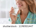 young woman drinking water from ... | Shutterstock . vector #1198501447