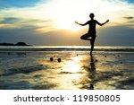 young woman practicing yoga on... | Shutterstock . vector #119850805