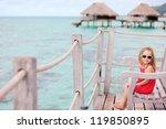 little girl at terrace of over...   Shutterstock . vector #119850895