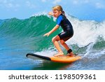 happy baby girl   young surfer... | Shutterstock . vector #1198509361