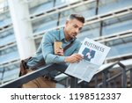 shocked middle aged man holding ... | Shutterstock . vector #1198512337