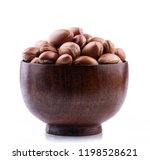 argan seeds in wooden bowl | Shutterstock . vector #1198528621