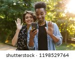 happy multiethnic couple at the ... | Shutterstock . vector #1198529764