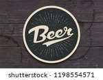 coaster for beer with hand... | Shutterstock .eps vector #1198554571