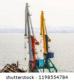 port cranes on commercial... | Shutterstock . vector #1198554784