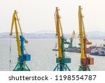 port cranes and ships on... | Shutterstock . vector #1198554787