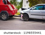Stock photo crashed car after accident ready to be tow away by tow truck 1198555441