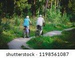 active senior couple riding... | Shutterstock . vector #1198561087