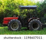 red tractor for transporting... | Shutterstock . vector #1198607011