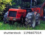 red tractor for transporting... | Shutterstock . vector #1198607014