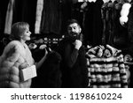 seller with beard and woman buy ...   Shutterstock . vector #1198610224