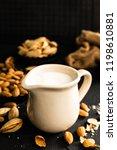 homemade almond milk in jug.... | Shutterstock . vector #1198610881