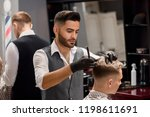 concentrated hairdresser making ... | Shutterstock . vector #1198611691