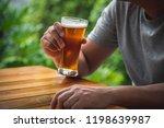 man drinking beer in the garden   Shutterstock . vector #1198639987