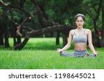 fitness asian woman doing yoga... | Shutterstock . vector #1198645021