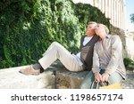 mature tourist couple sitting... | Shutterstock . vector #1198657174