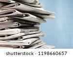 pile of newspapers on white... | Shutterstock . vector #1198660657