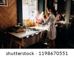florist dressed in a striped... | Shutterstock . vector #1198670551