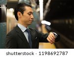 asian businessman in city... | Shutterstock . vector #1198692787