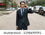 asian businessman in city... | Shutterstock . vector #1198699591