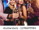 multiethnic friends in santa... | Shutterstock . vector #1198699984