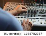 man sound engineer hands... | Shutterstock . vector #1198702387