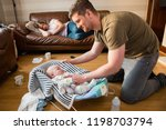father checking on his newborn... | Shutterstock . vector #1198703794