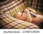 infant use mobile phone or... | Shutterstock . vector #1198715434