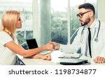 male doctor is talking to...   Shutterstock . vector #1198734877
