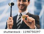 golden bitcoin and judge gavel... | Shutterstock . vector #1198750297