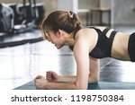 fitness asian woman doing yoga... | Shutterstock . vector #1198750384