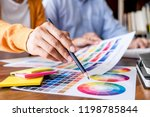two colleague creative graphic... | Shutterstock . vector #1198785844