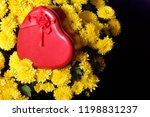autumn flowers in a pot. yellow ...   Shutterstock . vector #1198831237
