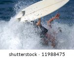 A Male Surfer Wipes Out During...