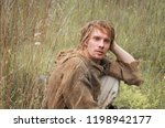 young shaggy and unshaven guy... | Shutterstock . vector #1198942177