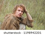 young shaggy and unshaven guy... | Shutterstock . vector #1198942201